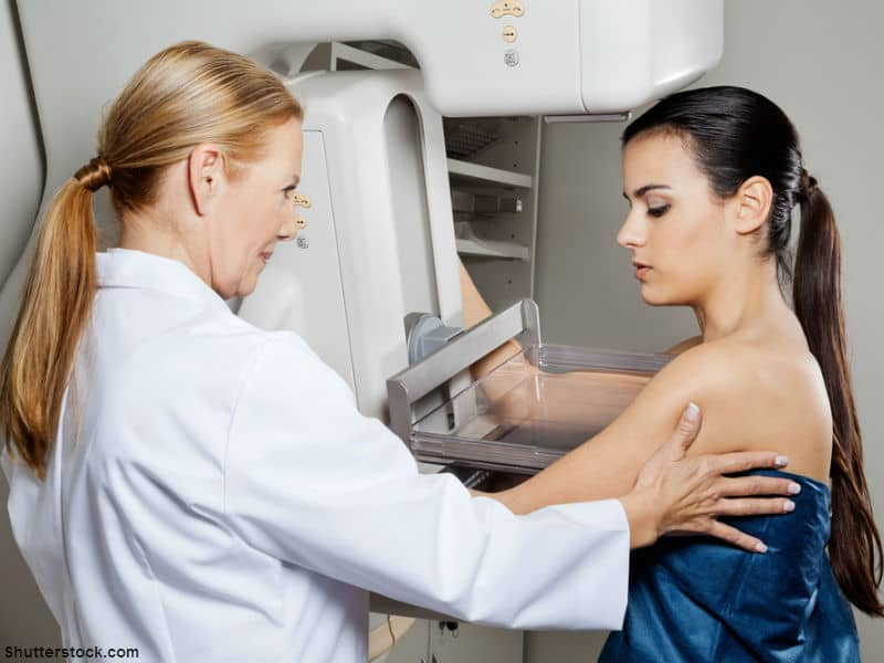 Doctor giving breast exam