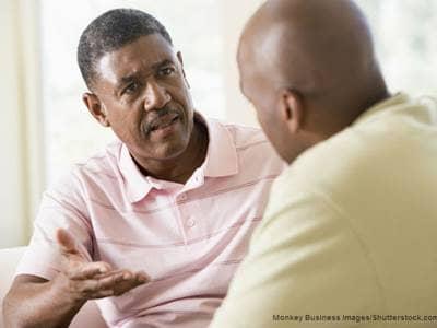 men talking in living room