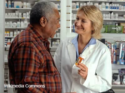 Man Consulting Pharmacist