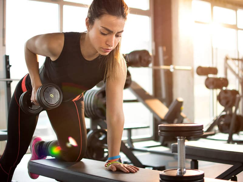 Woman using weights