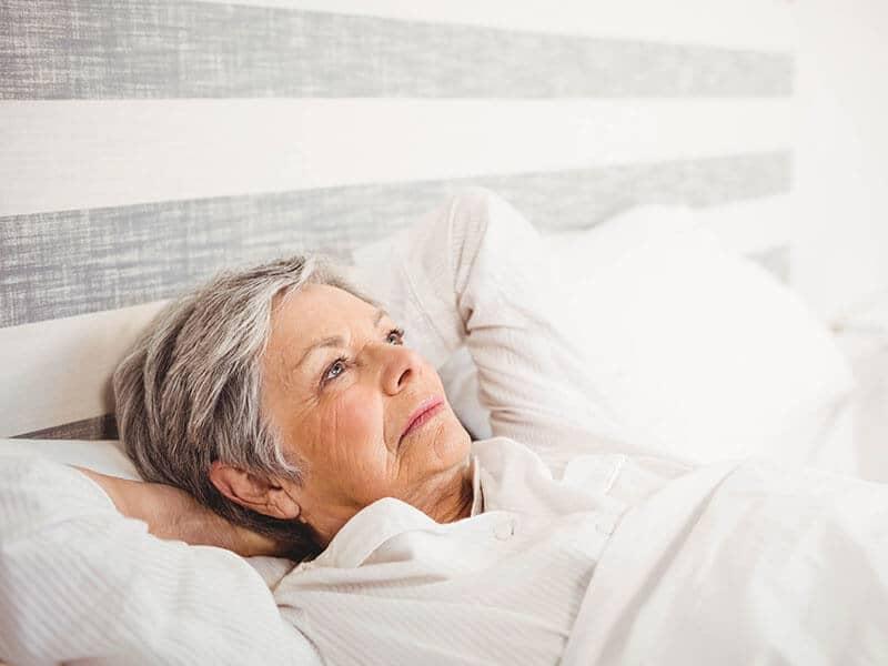 Senior woman sleep on back