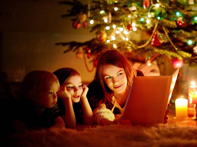 family reading at christmastime