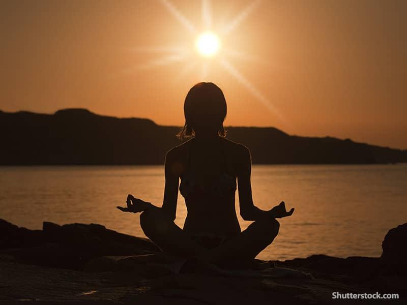 people woman meditating sunset