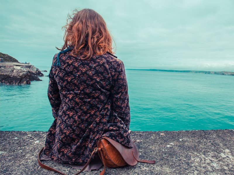 woman depressed looking at ocean