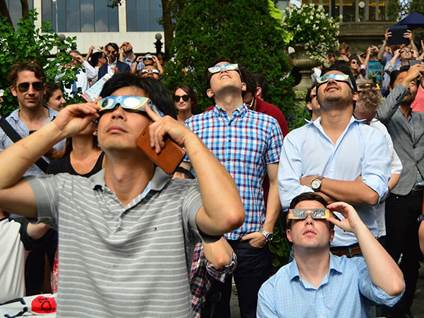 people viewing an eclipse