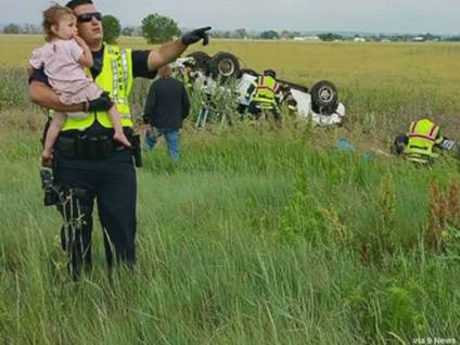 Man comforts child after car crash