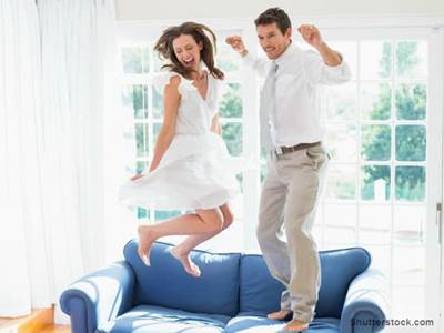 Couple Jumping on Couch