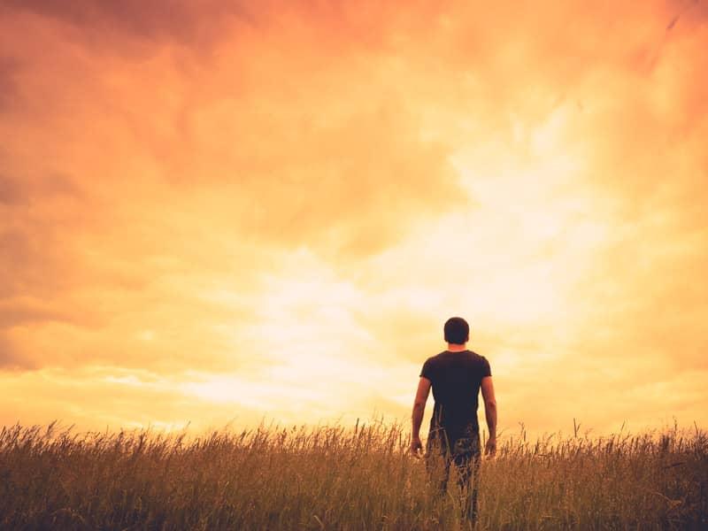 man standing sunset