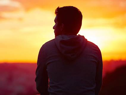 man thinking sunset