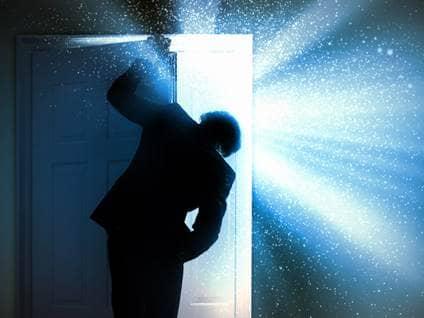 man opening door future