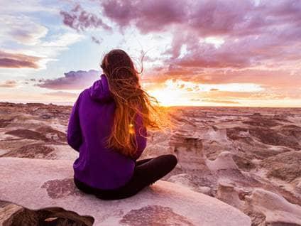 woman on desert cliff