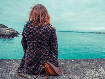 woman depressed looking at ocean