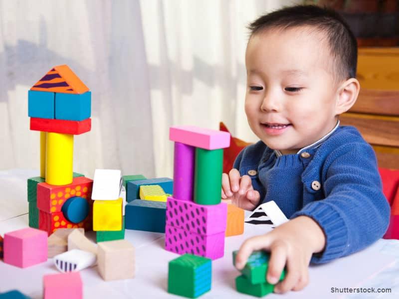 boy with toy blocks