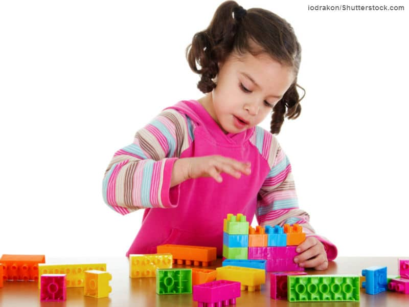 girl playing legos