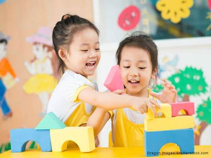 girls playing blocks