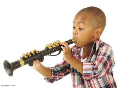kid playing toy clarinet