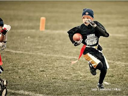 Kid Playing Football