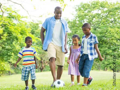 Dad Playing Soccer With Kids