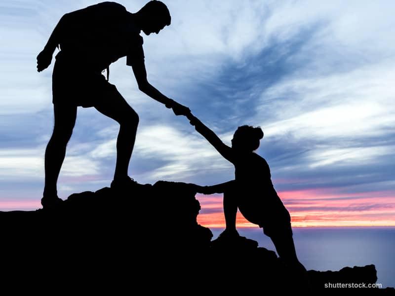 Couple Hiking Helping Climb