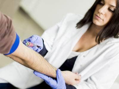 nurse drawing blood