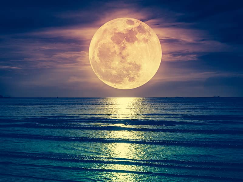 moon rising over water