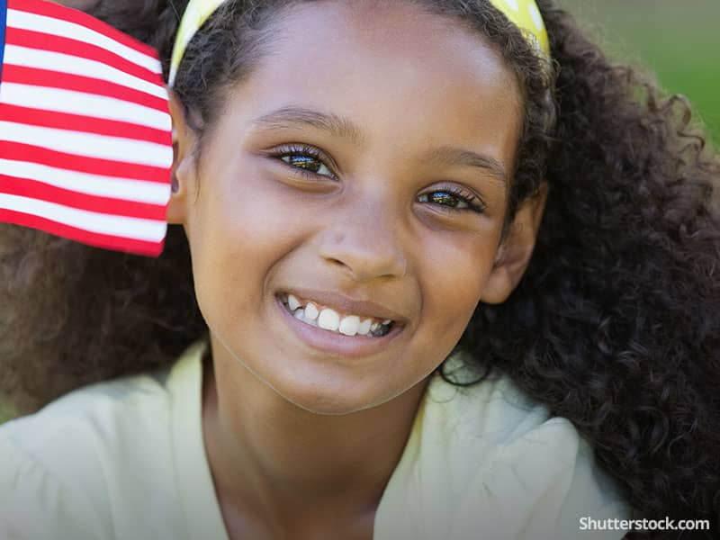 child-girl-smiling-flag