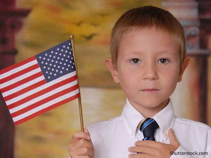 child-holding-flag-serious