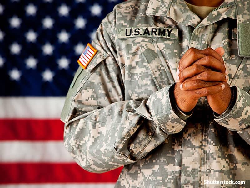 people soldier praying