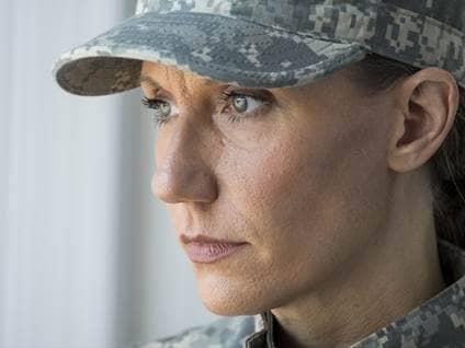 Contemplative Female Soldier