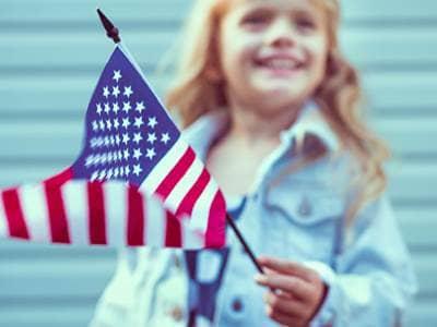 Girl Holding American Flag