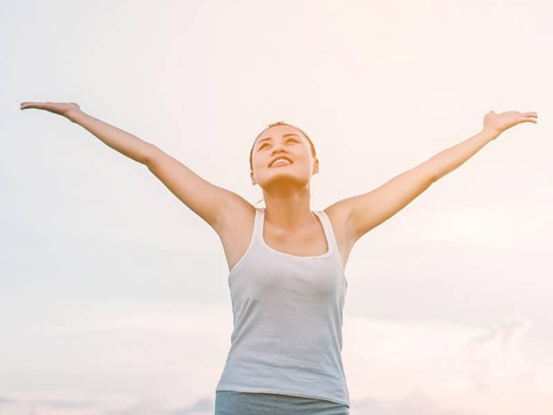happy woman praising