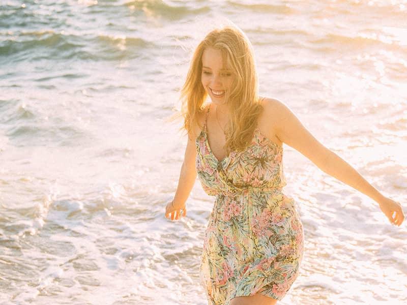 people-woman-happy-ocean-smiling-carefree