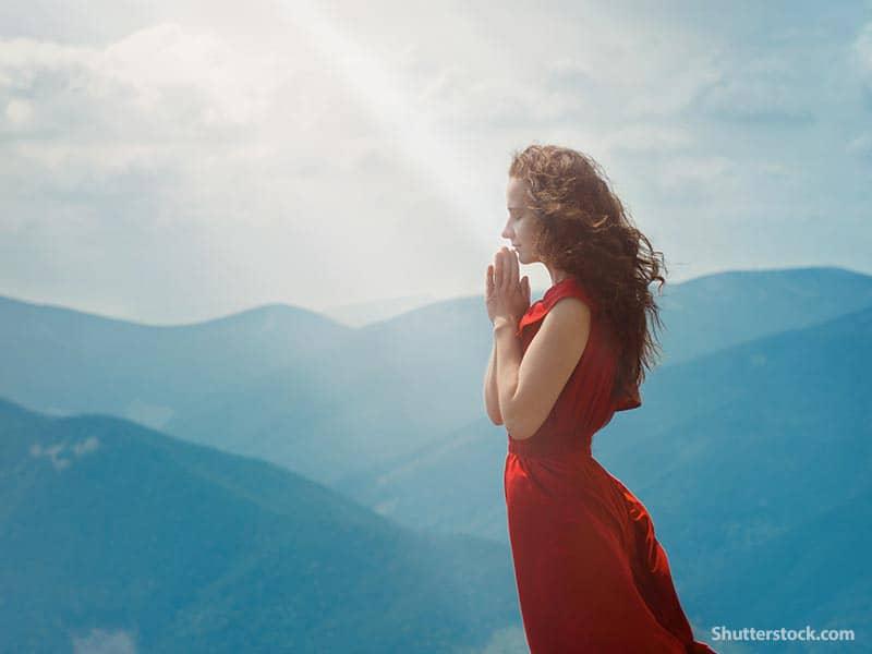 people woman praying mountain