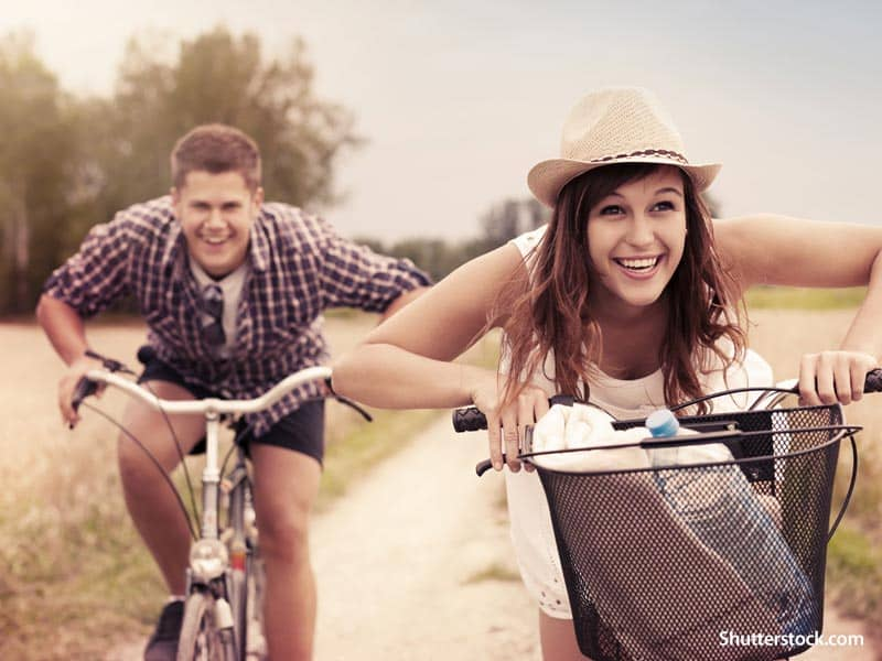 people couple riding bikes