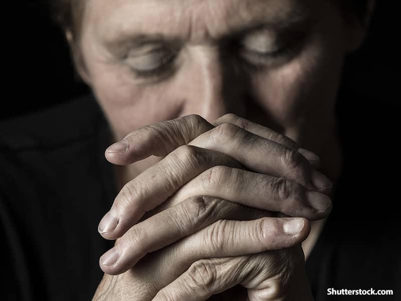 people elderly man praying