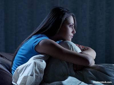 People in bed awake