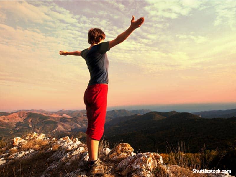 people woman praise mountain top
