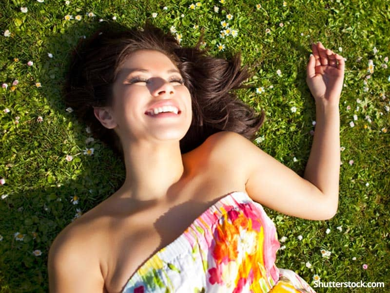 woman-happy-on-grass-spring-sun