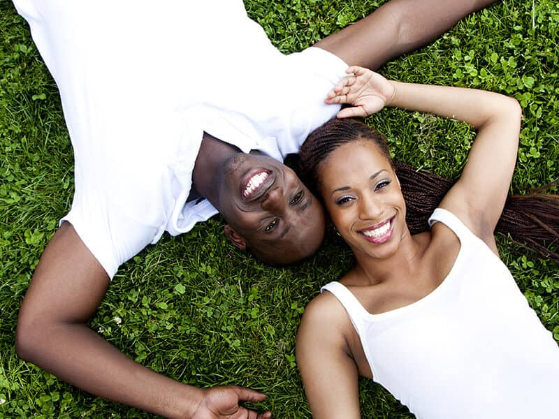 Happy couple laying on the grass