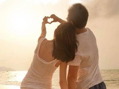 couple heart on the beach