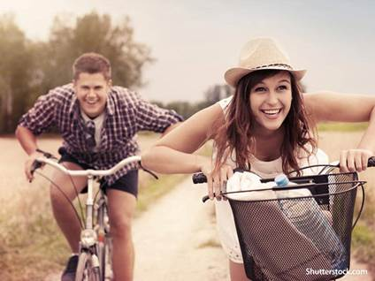 people couple riding bikes