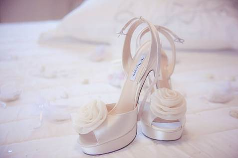 Bridal shoes on bed