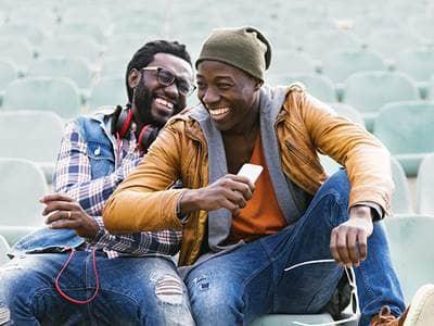 friends laughing men phone