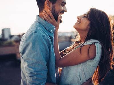 Woman smiling at man