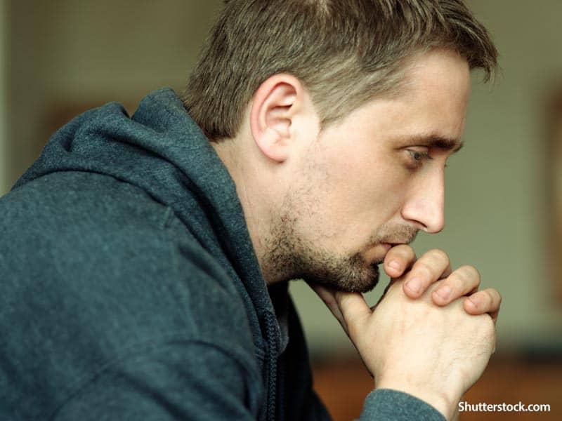Faith man praying church