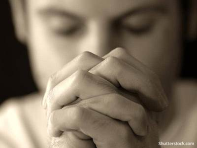 man-praying-sepia