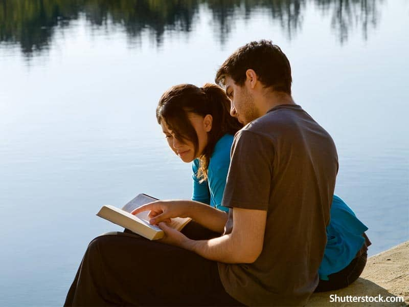 people couple reading bible