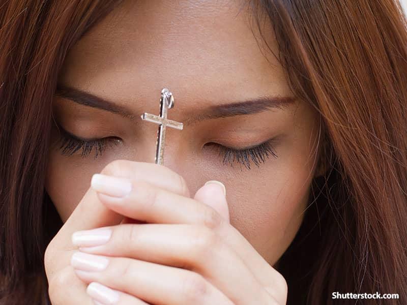 people girl praying cross