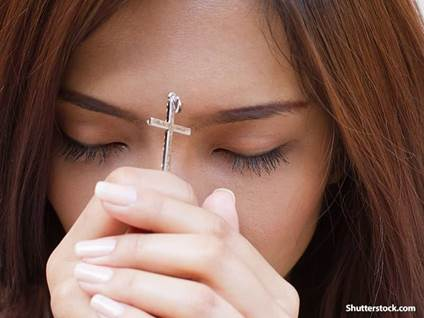 people girl praying cross