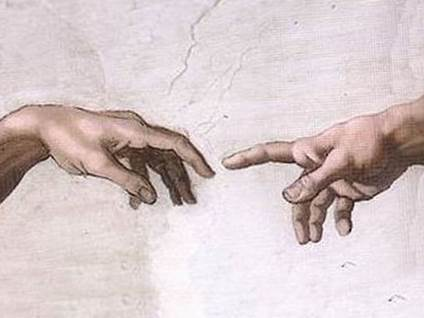 Human hand reaching for God's